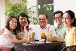 happy older people sharing cocktails