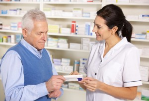 pharmacist serving older man