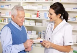 pharmacist serving older man