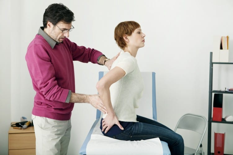 Chiropractor treating back pain