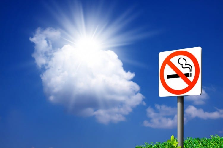Stop smoking sign on blue sky