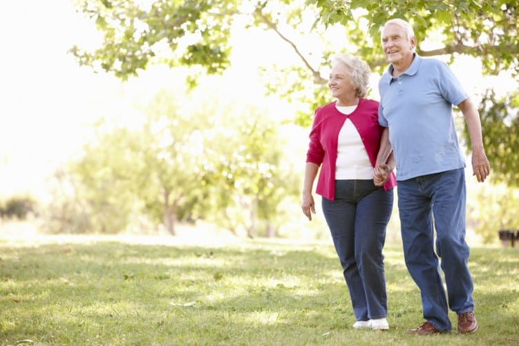 walking-older-couple-in-park